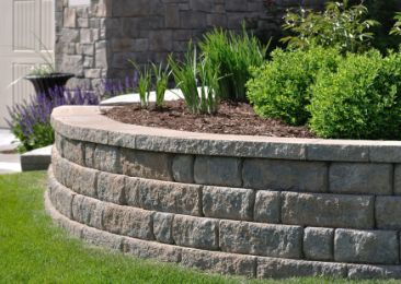simple limestone sleeper retaining wall with plants | Cairns Retaining Walls